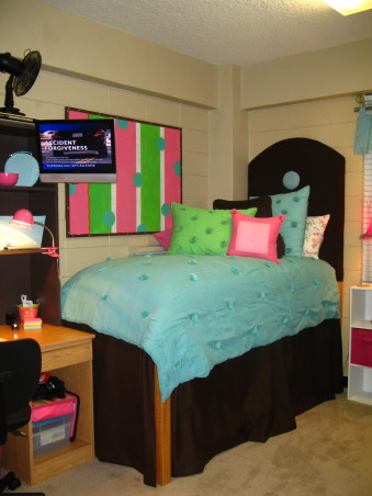"Girls Dorm Room-Fun & Functional with homemade headboards, Your typical dorm room with the drab block walls that we aren't allowed to paint.... as moms we all try to create that home away from home feeling for our children leaving the nest!!  Of course, those 1st pics of ""our"" creation for them is the only time it will look great! - Neat & clean, etc.!  So these were taken on moving day!  We made matching headboards & my talented mother pitched in on the sewing of the dustruffles!  The comforter & pillows I got from PB teen! - Along with the splurge on the rug (which was actually the inspiration for the room!)  We had the old bulletin board & painted that to match.   Our daughter loved her ""new"" room!, Notice What's on the TV!!  I couldn't resist this photo, but didn't realize that ad was on when I took it!  , Dorm Rooms Design"
