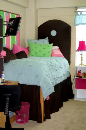 "Girls Dorm Room-Fun & Functional with homemade headboards, Your typical dorm room with the drab block walls that we aren't allowed to paint.... as moms we all try to create that home away from home feeling for our children leaving the nest!!  Of course, those 1st pics of ""our"" creation for them is the only time it will look great! - Neat & clean, etc.!  So these were taken on moving day!  We made matching headboards & my talented mother pitched in on the sewing of the dustruffles!  The comforter & pillows I got from PB teen! - Along with the splurge on the rug (which was actually the inspiration for the room!)  We had the old bulletin board & painted that to match.   Our daughter loved her ""new"" room!, Dorm Rooms Design"