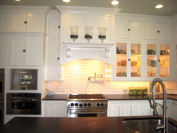 "Something's Gotta Give Inspired Kitchen, We built what was supposed to be our ""dream house"" in 2006-07, but I was designing the kitchen in my mind for years before that. I won't go into the gory details, but suffice to say we had a LOT of problems, many still outstanding, and it's likely the house may never be worth what we ended up paying for it, thanks to a crooked/incompetent contractor and other woes.   On the bright side, though it's not perfect, it's still pretty comfy, especially if you don't look too closely, and it's a lot nicer than any house I ever thought I'd live in, even in my wildest imagination. It wasn't that long ago that I was making Thanksgiving dinner for 12 in a tiny apartment with a 20-year-old coil top stove and 3 sq. inches of counter space, so I do know how very, very lucky I am.  I did all the design, from basic floor plan to decorating, myself, so blame me if you hate it. And, no, not everything is exactly as I'd like it, but the money tree didn't take root, so I work with what I have, including a lot of flat pack furniture. I was inspired by, among other things, the Hampton's beach house in the movie Something's Gotta Give, even though we're nowhere near the water, unfortunately. I guess I'd call my overall ""look"" cottage beach house via Pottery Barn.  To answer the most frequently asked question ... I'm an avid cook and baker and often feed a crowd so, yes, I really do use all those ovens. There are five, in case you're counting: two electric, one gas, a convection/steam oven and an Advantium.  Thanks to all who have taken the time to share comments, and a special thank you for all those folks who shared their own kitchen pictures, many of which inspired me. I am just trying to return the favor.  If you're interested in additional details and more photos, of the whole house, actually, you can go to: http://susanandmarkw.shutterfly.com, Range wall and mantle, without the much-hated star.          , Kitchens Design"