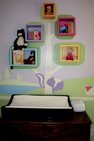 Northwoods Nursery, Fun and Funky girl's nursery, with just enough sugar and spice to sweeten a baby girl's day. , A shadow box tree is a fun storage solution. Lookout for the skunk! , Nurseries Design