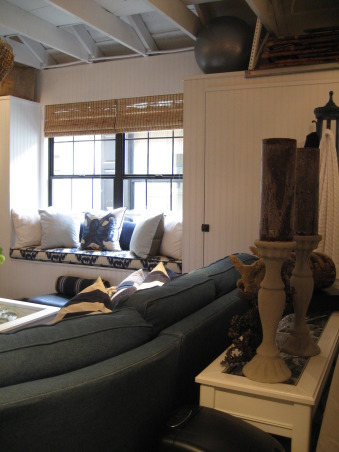 Family Room (but in the Garage!!), We originally made over our garage for our teenage son and his friends but it's become our favorite room in the house!! We built out just to the garage opening on both sides so we could gain some storage cabinets. The bead board is so seamless that you forget there are storage cabinets in the room. We also put in a pull down ladder and made use of the overhead storage space which is quite large and holds a ton of stuff. We acid stained the floor and added low voltage track lighting. , Living Rooms Design