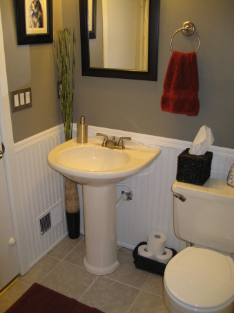 small bathroom remodel, A sleek gray and white bathroom with red accents, stainless steel, and dark woven baskets to add texture., Most of the accessories, I found at Hobby Lobby, Bed Bath and Beyond, and Walmart.   , Bathrooms Design