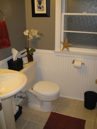 small bathroom remodel, A sleek gray and white bathroom with red accents, stainless steel, and dark woven baskets to add texture., I painted the walls a slate gray and the wainscotting and trim a bright white. I added red to pop off the gray.      , Bathrooms Design