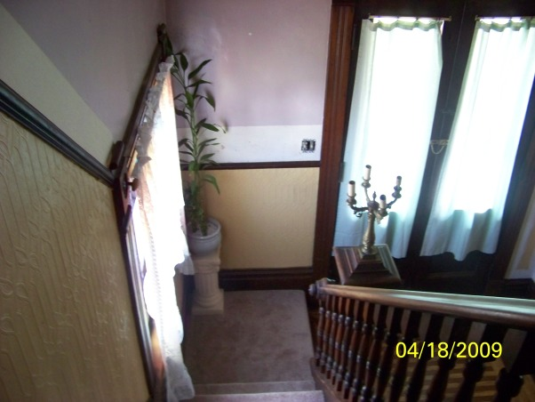 please help!! need paint ideas for staircase, foyer, hallway, this area begins at foyer/entranceway up staircase, and through a large hallway. it is currently painted yellow on the lower half of what seems like a chair-rail, then is violet on the upper half, up staircase, and through hall. i typically paint my rooms with neutrals like white, antique, creams, beigh's (boring, i know--but i'm not into yellow & purple). the trim all around this space is cherry. (Banister, baseboards etc.) this, i do not want to paint. the problem for me is choosing 2 colors, one for each half of the chair-rail, which will compliment each other without being too boring, but not over the top either., this is the view at the stairway landing. you can see my window on the left--which has stained glass in it, and my French doors, as the main entrance. Here, you see I have started to paint the trim out in primer., Other Spaces Design