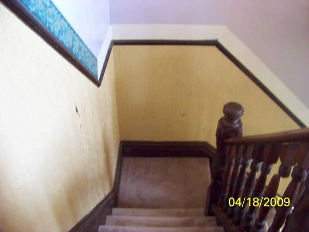 please help!! need paint ideas for staircase, foyer, hallway, this area begins at foyer/entranceway up staircase, and through a large hallway. it is currently painted yellow on the lower half of what seems like a chair-rail, then is violet on the upper half, up staircase, and through hall. i typically paint my rooms with neutrals like white, antique, creams, beigh's (boring, i know--but i'm not into yellow & purple). the trim all around this space is cherry. (Banister, baseboards etc.) this, i do not want to paint. the problem for me is choosing 2 colors, one for each half of the chair-rail, which will compliment each other without being too boring, but not over the top either., this is the best view to represent what I'm referring to. this color scheme is throughout the foyer, staircase and hallway. the yellow portion is a nice textured matieral., Other Spaces Design