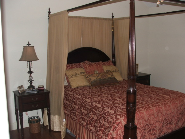 Semi Romantic Bedroom w/ BLAH Walls!, My master bedroom has very little space and hardly any accessories or style. I need a complete redo. Would love a romantic chic feel but I am anti- contemporary. I need some ideas on how to blend different theme's together and incorporate my love for antiques!, Master bedroom 4 poster bed and nightstand. , Bedrooms Design