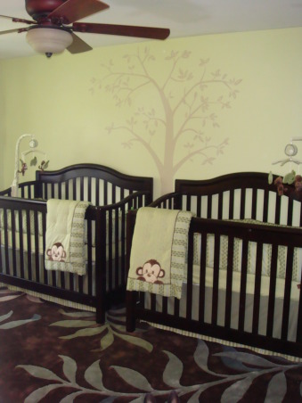 Twin Boys' Nursery, We couldn't be more excited about the arrival of our twin boys in July 2009, so we got started on their nursery early.  We hope they love it as much as we do!, Side-by-side ebony cribs with monkey bedding and a tree decal., Nurseries Design