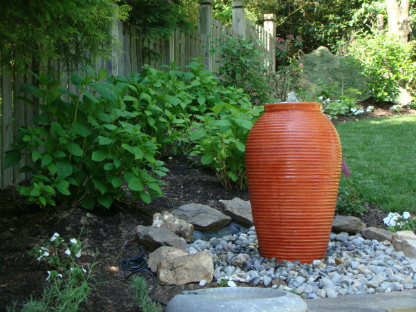 Love this small backyard!, This is my backyard with our new water feature.  Love the urn...it adds a much needed focal point.  Can't wait till the hydrangeas bloom!, the new water feature...still pics don't do it justice!   , Gardens Design