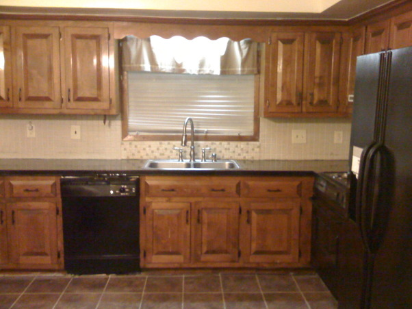 redo-painted my laminate countertops to look like granite!!!, Ok, so i have had 3 attempts at my living room color...but my kitchen is on the 5th color in the last 5 months and i am sure there is no right color for this kitchen! I need help. I love neutrals and earth tones but i have no idea how to make this horrible kitchen work., Kitchens Design