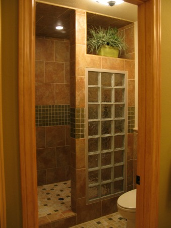 Master Bath Remodel with Open Walk-in Shower for Empty Nesters, Master bathroom remodeled into master walk-in shower, featuring wood-framed glass privacy door, glass block shower divide, open shower entry, and randomly placed glass tile., Looking into master bath from master dressing area         , Bathrooms Design