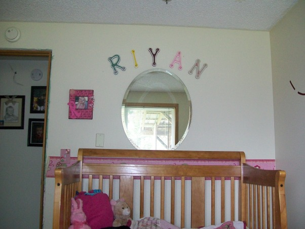 3 year old's room, butterflies, flowers, and all a 3 year old wants., oval mirror and name above her bed., Girls' Rooms Design
