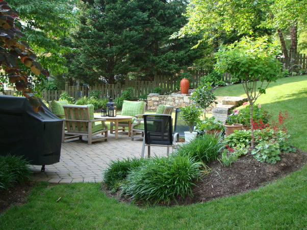 Love this small backyard!, This is my backyard with our new water feature.  Love the urn...it adds a much needed focal point.  Can't wait till the hydrangeas bloom!, View of the yard , Gardens Design