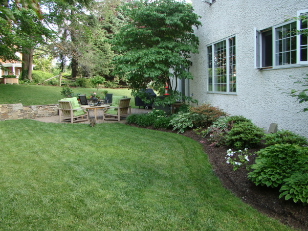 Love this small backyard!, This is my backyard with our new water feature.  Love the urn...it adds a much needed focal point.  Can't wait till the hydrangeas bloom!, Yard view from the other side , Gardens Design