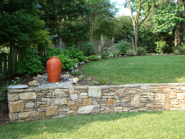 Love this small backyard!, This is my backyard with our new water feature.  Love the urn...it adds a much needed focal point.  Can't wait till the hydrangeas bloom!, The new water feature , Gardens Design