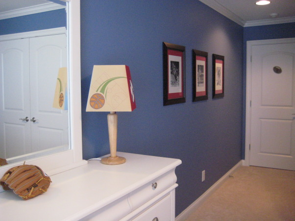 Sports themed boys bedroom., Pottery Barn inspired boys bedroom., Lamp is from Target and framed black and white photos are action shots of sports legends., Boys' Rooms Design