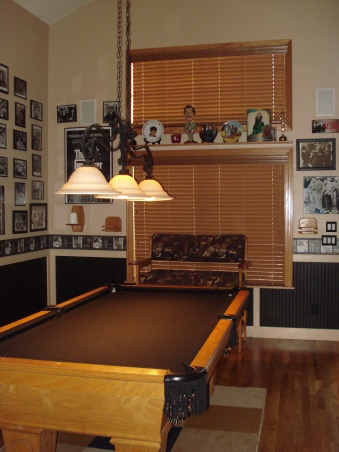 Pool table/game room, Made a formal living/dining room into a classy pool table/ game room.  We added our favorite hollywood memorabilia., This picture is a better look at the framed in windows and wood blinds.  , Other Spaces Design