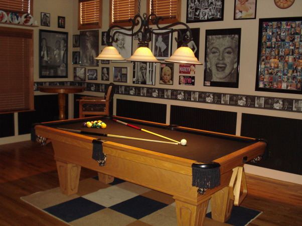 Pool table/game room, Made a formal living/dining room into a classy pool table/ game room.  We added our favorite hollywood memorabilia., A hollywood themed border circles the room above the beadboard. My husband also refelted the pool table in black. We also replaced the pool light for a cheap price and painted it black. , Other Spaces Design