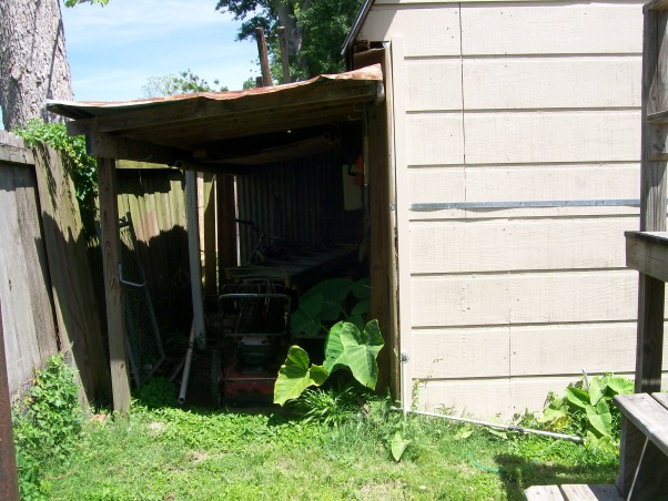 Backyard Catastrophe, Stairs to nowhere, 40 randomly placed stepping stones, uneven ground...What were they thinking? This is our first house and we really want to clean up the backyard.  It is truly a safety hazard! As I was out taking pictures, I stepped down off of the steps to nowhere and broke my foot on the stepping stone at the bottom! Yesterday, my father-in-law picked up most of the stepping stones and removed the stairs. But we still have a long way to go! We want to arrange the 16 inch stepping stones in a patio format and get some nice patio seating. The shed is somewhat in the way though. We plan to remove the dog fence and tetherball pole. Of course our plants are random and overgrown; we want to rearrange and remove some of them. We need ideas! HELP!, This lean-to is full of bees and hornets! It's gotta go!, Yards Design