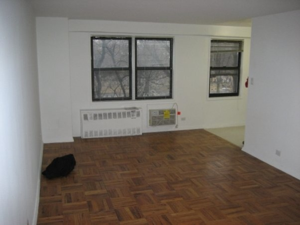 "Studio Apartment - Living Room / Bedroom combo, A studio apartment in NYC - a few miles outside of Manhattan.  Only about 500 square feet, there is still plenty of living and storage space!  Bamboo shades to allow lots of light; storage ottomans that double as coffee tables; a couch that easily folds down into a bed, but also has a large storage area underneath;  and, of course, the 42"" plasma TV on the wall :-), BEFORE! , Living Rooms Design"
