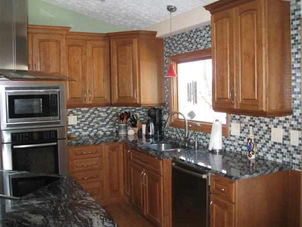 Our Dream Kitchen, We transformed our old 1980's kitchen with up-to-date materials and appliances, including granite counter tops, glass tile backsplash, and conduction cooktop., Kitchens Design