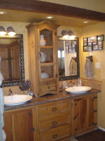 Rustic Master Bath, Our master bath has a dresser as the vanity cabinet, a granite countertop, vessel sinks, a stone wall and a step down shower., Rustic Pine vanity with granite countertop, vessel sinks, tall cabinet defines his & her spaces., Bathrooms Design