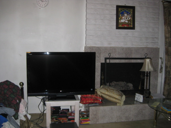 TV Area, We have a TV and our fireplace, We are keeping our cable box, dvd box, and tv on the floor., Unmounted tv, dvd box, and cable box, Living Rooms Design