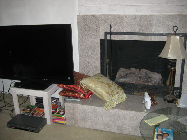 TV Area, We have a TV and our fireplace, We are keeping our cable box, dvd box, and tv on the floor., Another view of our living room, We stack our pillows on the side, we do not have much room., Living Rooms Design