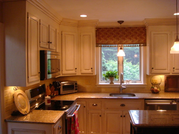 French Country Farmhouse, An affordable kitchen makeover including hand painted & glazed cabinets, custom carpentry accents like crown and picture molding, recessed lights, under cabinet lighting and ceramic tile with unique layout.  The changes to our kitchen left the 80's as a part of its' past. , Kitchens Design