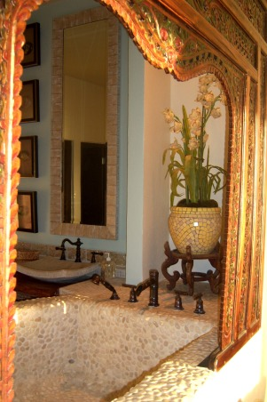 Bali Style Bathroom, This master bathroom is a reflection of our master bedroom, exotic, organic and Bali inspired. For more photos go to my facebook page https://www.facebook.com/pages/Bo-Bendana/116789411711625?sk=wall, We chose to use the pebble tile because we love the textured look and  feel. The faucets are bamboo inspired for that extra Asian touch.  The teak arch was hand carved and painted in Bali.  , Bathrooms Design