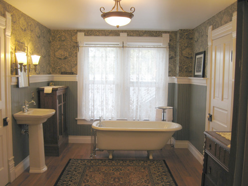 "1890's Victorian Gets A New Bathroom, It was a bedroom 10.5' by 15.0', then a storage room.  Now it is a peaceful grayed blue-green bathroom featuring a 1903 Kohler tub.  Come see the rest of our house at www.1893victorianfarmhouse.blogspot.com, 3/4"" beadboard painted a restful and manly grayed blue-green.  Added convenient storage, using a jelly cabinet, and walnut dresser. The door on the left is a huge closet with washer & dryer.  The door on the right is another huge walk-in closet for out of season clothes and holiday decorations.       , Bathrooms"