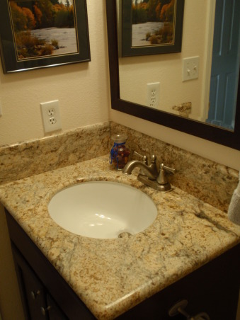 Small, updated half bath, Wish I had a before picture- the counters were blue formica, the floor was linolieum that always looked dirty, and there were blue birds painted on the ceiling. , framed mirror replaced the old one that was glued to the wall., Bathrooms Design