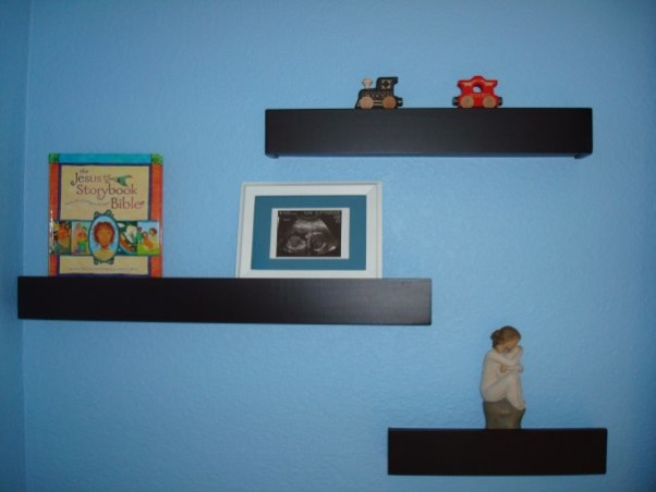 Baby Boy's Monkey Room, A nursery for our baby boy, coming in August.  We wanted to buy gender-neutral bedding, so that we could use it again if we have a girl next time.  But by using blue paint and adding other accessories, it still looks like a little boy's room., The train on the top shelf will spell out his name, once he's here! , Nurseries Design