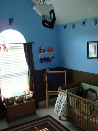 "Baby Boy's Monkey Room, A nursery for our baby boy, coming in August.  We wanted to buy gender-neutral bedding, so that we could use it again if we have a girl next time.  But by using blue paint and adding other accessories, it still looks like a little boy's room., The ""F"" above the window will have letters on either side of it, but we're not revealing his monogram until he's born.  The monkey border, bedding and many of the accessories are from Babies R Us. , Nurseries Design"
