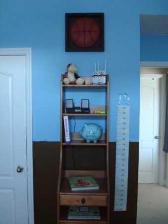 Baby Boy's Monkey Room, A nursery for our baby boy, coming in August.  We wanted to buy gender-neutral bedding, so that we could use it again if we have a girl next time.  But by using blue paint and adding other accessories, it still looks like a little boy's room., I'm not satisfied with the organization of these shelves--I want to rearrange some things to make it look more cohesive. , Nurseries Design