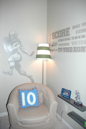 BOYS FOOTBALL ROOM, My son wanted a Cowboys Football themed room.  I didn't want to have to change the room as soon as he chose a new favorite team. So here's my compromise., We used this small corner to create a reading area.  The peel and stick football words and football player are easily removed.  The chair is slipcovered so it can be easily cleaned when life's little accidents happen. , Boys' Rooms Design