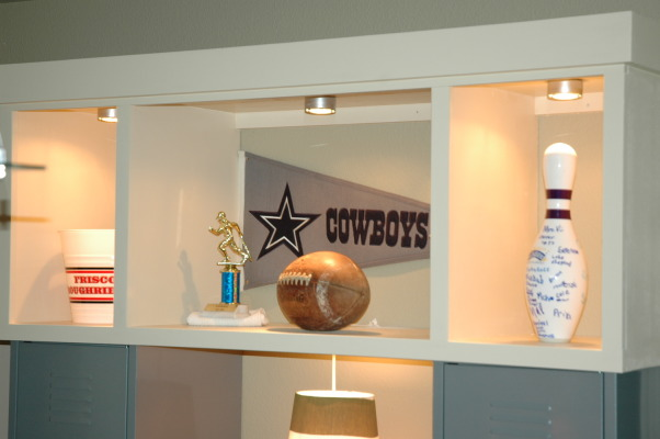 BOYS FOOTBALL ROOM, My son wanted a Cowboys Football themed room.  I didn't want to have to change the room as soon as he chose a new favorite team. So here's my compromise., I knew my sons would be accumulating lots of sports trophies and memorabilia over the next few yrs. So we created this display area to show them off. , Boys' Rooms Design