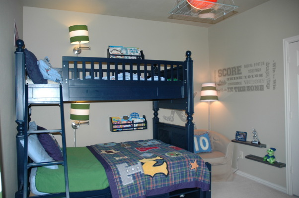 BOYS FOOTBALL ROOM, My son wanted a Cowboys Football themed room.  I didn't want to have to change the room as soon as he chose a new favorite team. So here's my compromise., We used a twin over full bunkbed for lots of sleeping space.  To personalize each sleeping area, we added a swing arm lamp and book bins.  , Boys' Rooms Design