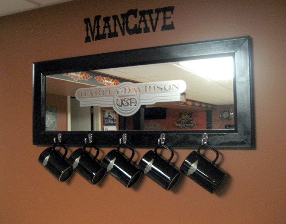 Harley Man Cave, This is my husband's ode to Harley Davidson/Crown Royal Man Cave., bought this mirror at a garage sale, spray painted it black, added new hardware and added the Harley Davidson decal., Basements Design