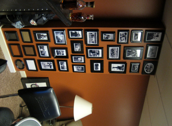 Harley Man Cave, This is my husband's ode to Harley Davidson/Crown Royal Man Cave., I have been collecting 4x6 & 5x7 frames for quite some time. I spray painted them all black and added photos from some of our motorcyle rallies and road trips. people just love looking at our scrapbook on the wall., Basements Design