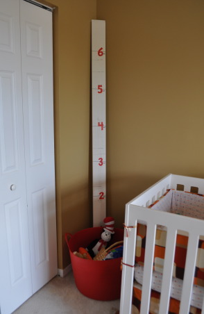 Vintage Modern Nursery, This nursery combines vintage accents with modern furnishings to create a cozy contemporary room for our little guy.  , Growth chart- portable doorpost in case we move someday.  Underneath is a bucket that makes a quick room cleanup easy.   , Nurseries Design