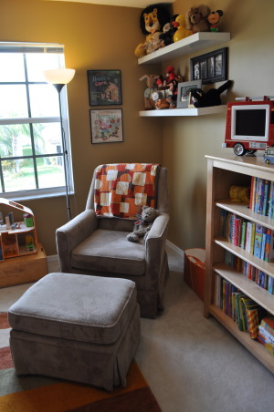 Vintage Modern Nursery, This nursery combines vintage accents with modern furnishings to create a cozy contemporary room for our little guy.  , I like having the bookcase within arm's reach of the chair.  We sit and read there before each nap and before bed.  Then you can just drop the books into the orange bin next to the chair until you have time to put them away since your arms are full of tired baby. , Nurseries Design