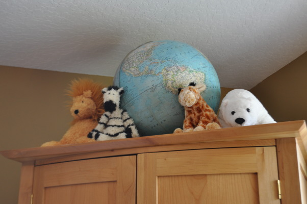 Vintage Modern Nursery, This nursery combines vintage accents with modern furnishings to create a cozy contemporary room for our little guy.  , Atop the armoire are stuffed animals bought new for the kids and an old globe.   , Nurseries Design