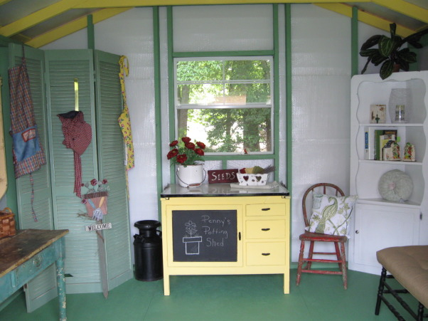 My Garden Shed, This area in our yard began with a ready-made building created by local Amish.  The arbor/potting shed was built by a builder friend and the inside was co-created by a decorator friend and myself.   , When you walk into the garden shed, you see the Hoosier cabinet.  The walls are white, studs are green, floor is green, and the beams are yellow.   , Gardens Design