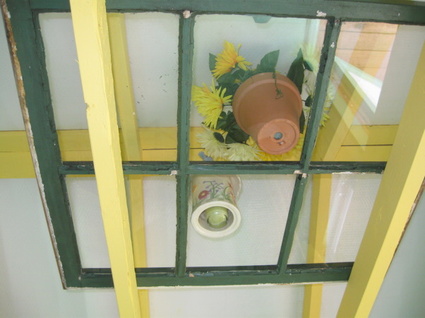 My Garden Shed, This area in our yard began with a ready-made building created by local Amish.  The arbor/potting shed was built by a builder friend and the inside was co-created by a decorator friend and myself.   , This is one of the window panes on the beams.  , Gardens Design