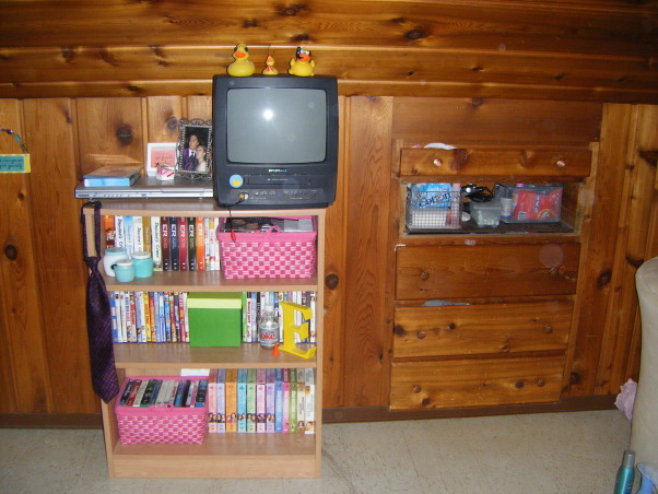 College Student Bedroom, Top level of house, bedroom , Built in dresser drawers and bookshelf containing tv , Bedrooms Design