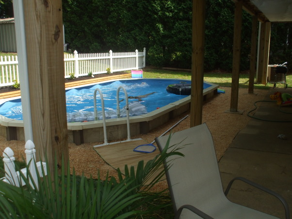 Semi Inground pool project 8 Photos, How to bury and aboveground pool,,,on a budget 4 months,$2000.00 and I lost 25-30 pounds.(I needed to anyway), View from under the porch/addition ,,,See my other space to wiew my addition on a budget,,,.      , Pools Design