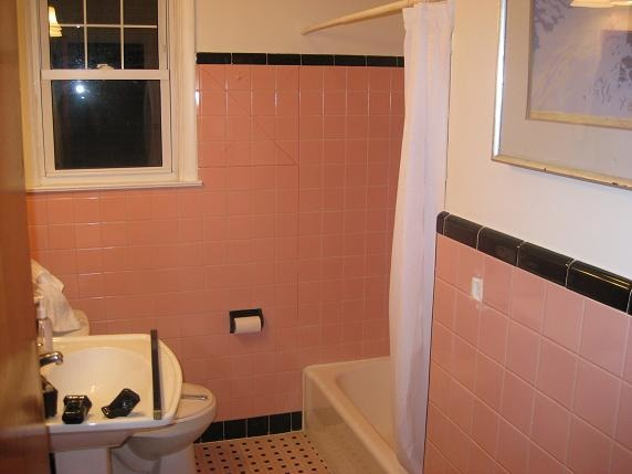 DIY bathroom redo, In the 50's pink and black tiled baths were all the rage.....not so much these days.  We just couldn't take the pink anymore.  This a DIY redo for under $700.  , Outdated and dingy , Bathrooms Design