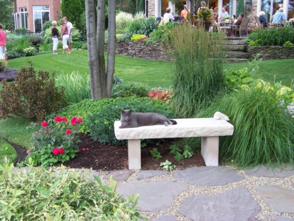 Golf course garden has a party, There's no better time to share your garden than mid July. The annuals have filled in, the perennials are overflowing and the foliage is still slug-hole free., Smokey thinks parties are boring., Gardens Design