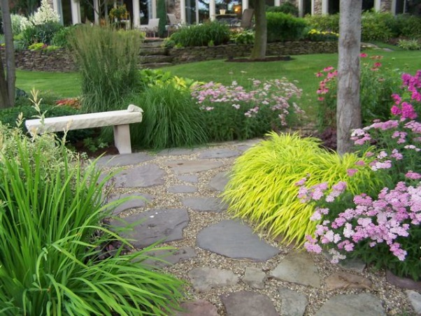 "Golf course garden has a party, There's no better time to share your garden than mid July. The annuals have filled in, the perennials are overflowing and the foliage is still slug-hole free., The grass is Hakonechloa macra ""All Gold."" It really pops here in the shade. , Gardens Design"
