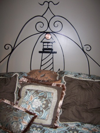 Lighthouse Bedroom, The bedroom is average size and accomodates a California King size bed with the custom iron headboard made by my husband., Headboard made by my husband out of iron., Bedrooms Design